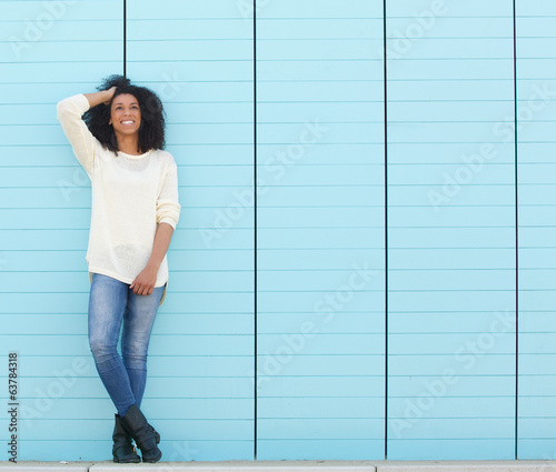 Cute young woman posing outdoors