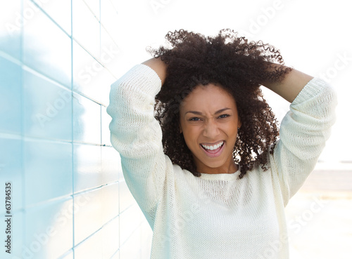 Black female fashion model smiling