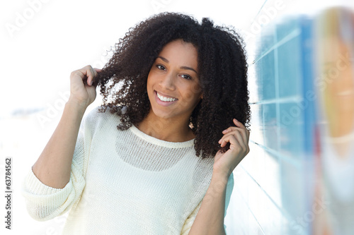 Beautiful mixed race woman smiling outdoors