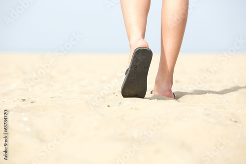 Sandals walking on sand at the beach