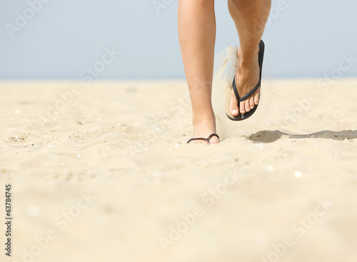 Walking forward in flip flops on beach