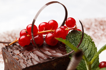 Chocolate cake with red currant