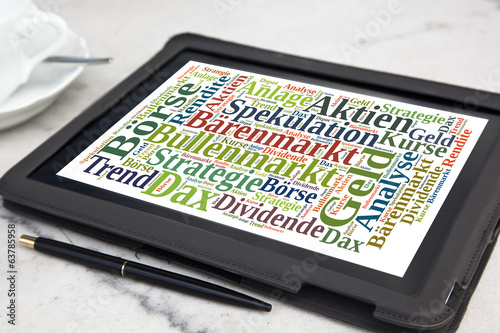tablet with stock market word cloud