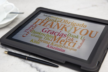 tablet with thank you word cloud
