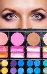 Closeup of beautiful womanish eyes with makeup kit