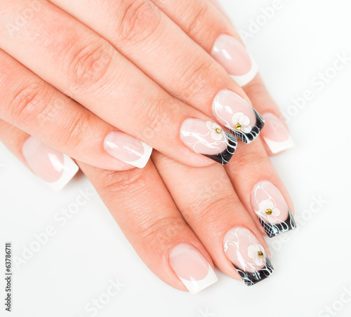 Beautiful hands with manicure on a light background