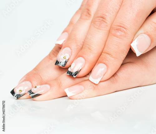 Beautiful female hands with manicure on a light