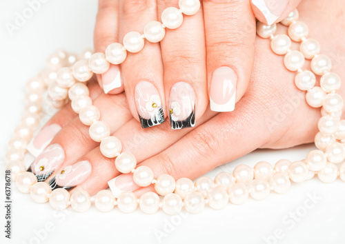 Female hands with manicure closeup on light