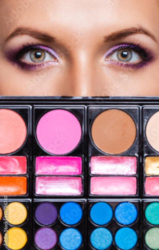 Closeup of beautiful womanish eyes with makeup kit