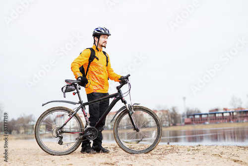 Healthy lifestyle, young man biking