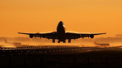 Airplane sunrise take-off