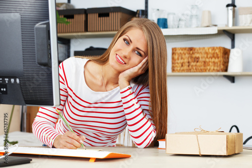 Lifestyle. Attractive girl at work