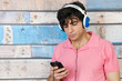 Man listening to music with smart phone