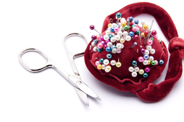 a pin cushion on white background