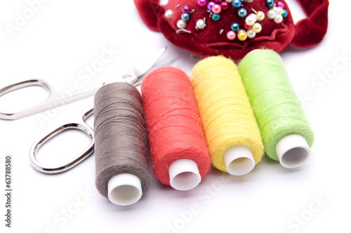 threads for sewing on a white background