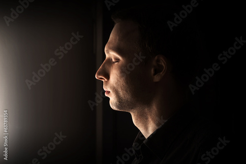 Closeup profile portrait of young Caucasian man with closed eyes