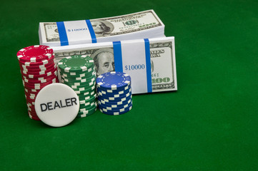 Stack of cash with poker chips