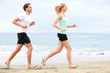 Couple running outdoors on beach