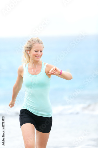 Running woman jogger with heart rate monitor watch