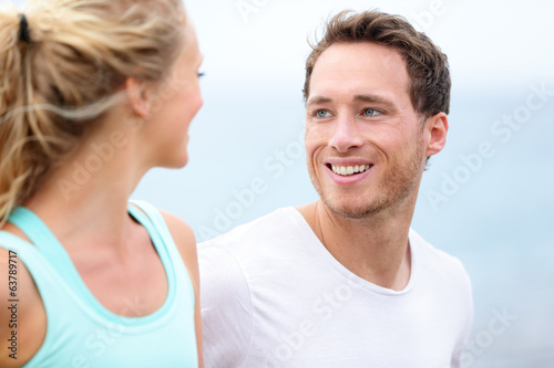 Couple jogging training together running on beach