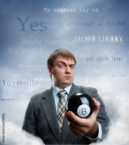 Businessman holding magic ball