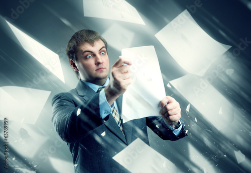 Businessman with sheets of white papers