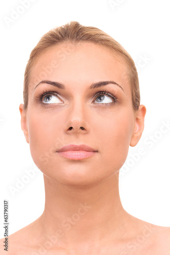 Beautiful woman's face on white background close-up