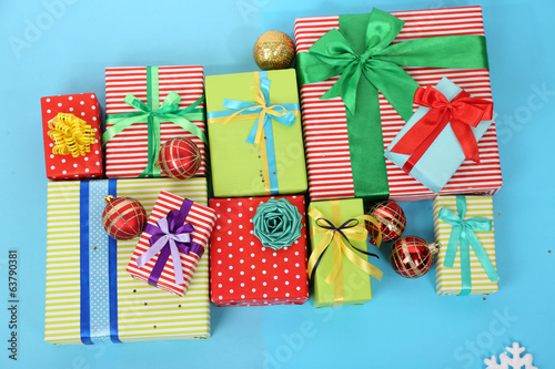 Many colorful presents with luxury ribbons  on color