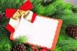 Christmas card on fir branch close up