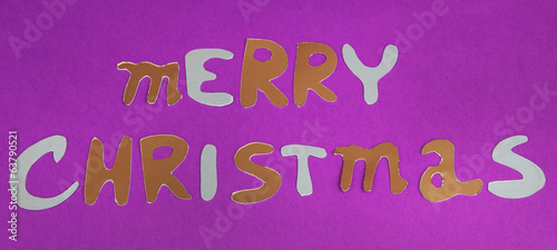 Merry Christmas lettering on purple background