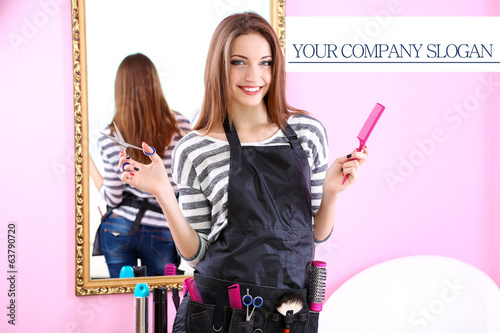 Beautiful girl hairdresser in beauty salon