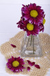 Flowers in a glass vase on a light background
