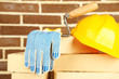 New bricks and building tools on brick wall background
