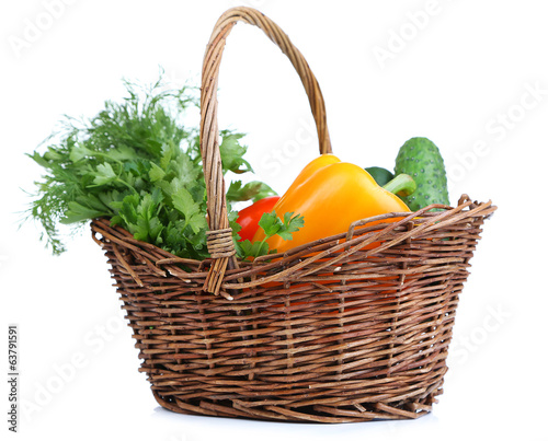 Composition with raw vegetables in wicker basket isolated