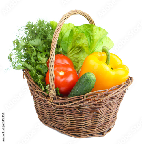 canvas print picture Composition with raw vegetables in wicker basket isolated