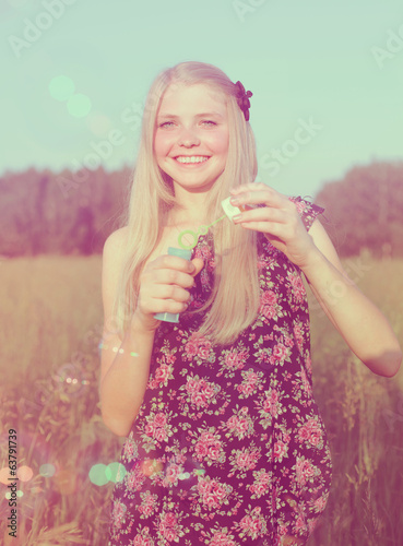 Smiling girl with soap bubbles