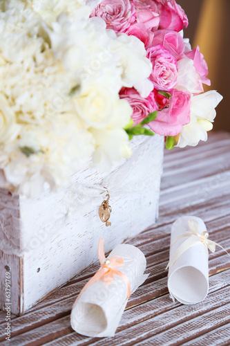 Beautiful wedding flowers in crate on table close up