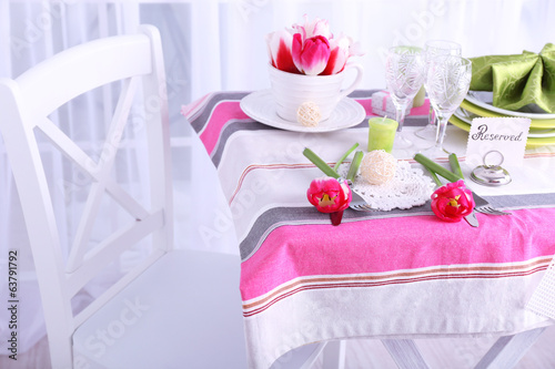 New table with place settings on light background