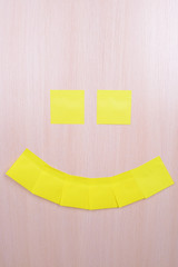 Smile made of adhesive note close-up