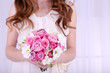 Woman hands holding beautiful wedding bouquet