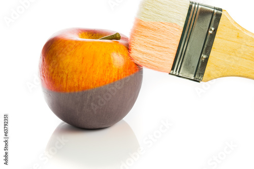 painting a fresh red apple black and white