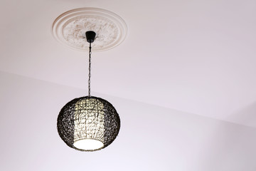 Modern chandelier hanging from ceiling