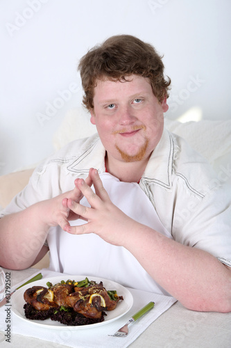 Tasty lunch for fat man, on home interior background
