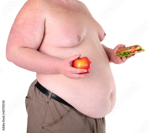 Fat man holding sandwich and apple, isolated on white