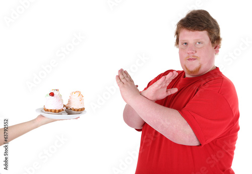Fat man with creamy cake isolated on white