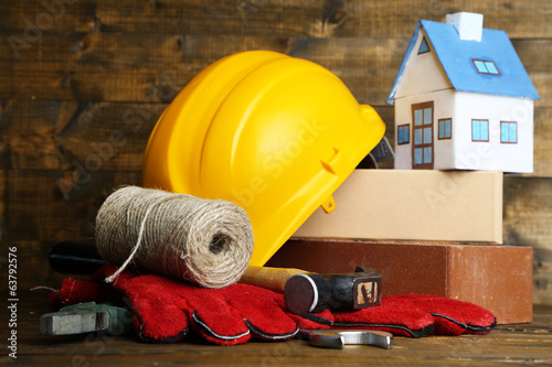 Composition with safety helmet, leather gloves, tools and