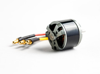 Small electric motor and wires on white