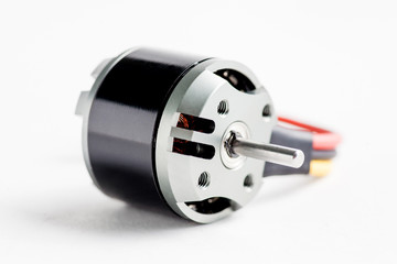 Small electric motor on white
