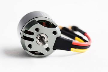 Electric motor of a small  size on white