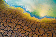 Polluted water and cracked soil
